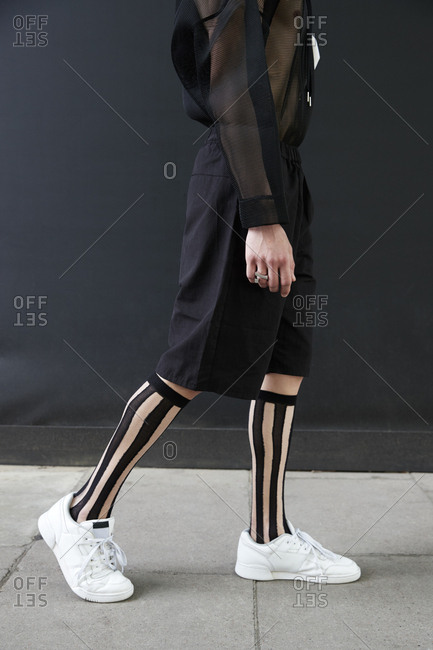 London, England - June 11, 2017: Low section of a man in black culottes and knee high socks