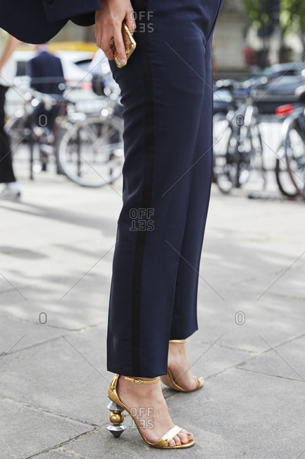 London, England - June 11, 2017: Woman in black cigarette trouser and high heels, low section