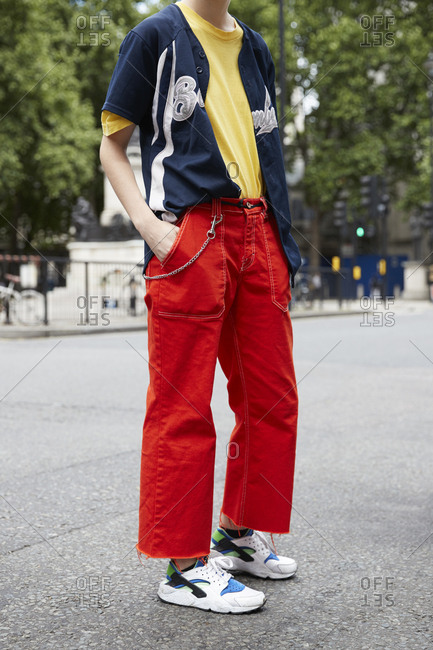 London, England - June 11, 2017: Man in a red trousers with large pockets and baseball shirt