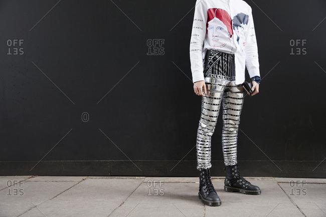 London, England - June 11, 2017: Man in metallic striped trousers and white shirt, horizontal