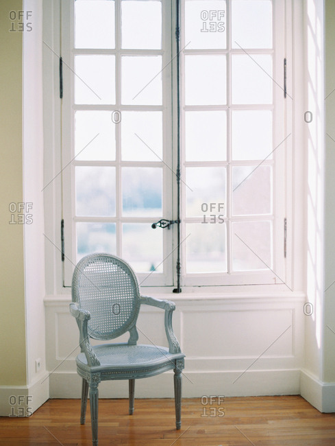 Antique chair by high window