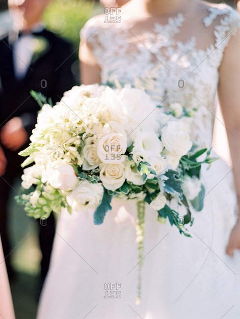 Bride with bouquet during wedding