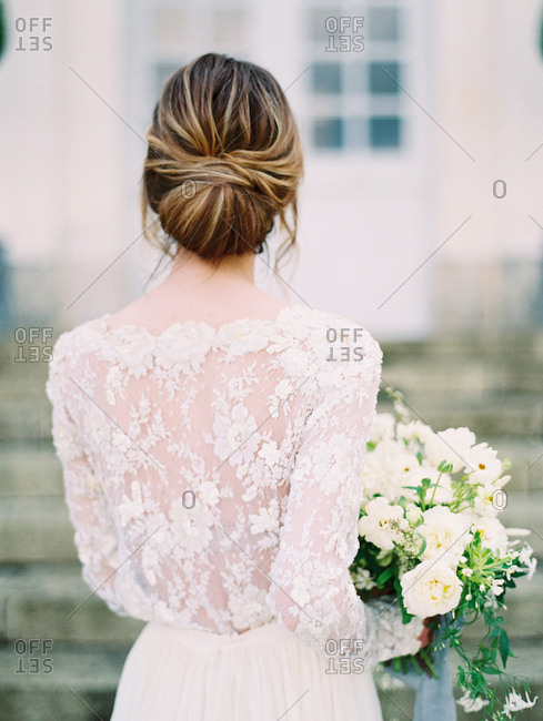 Bride with lace back dress by chateau