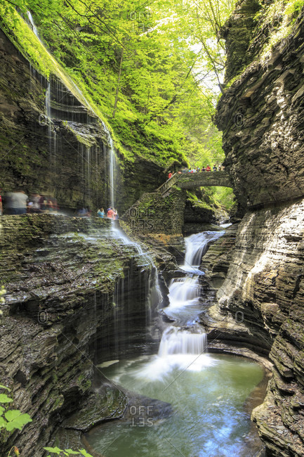 Watkins Glen State Park, New York, United States - May 24, 2015: Waterfalls cascade through Watkins Glen State Park in New York.