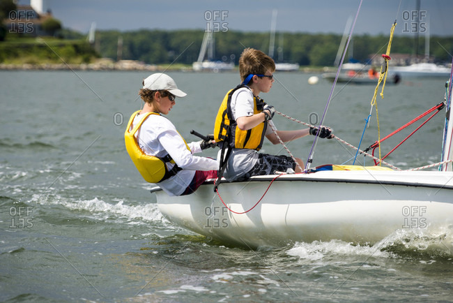 North Kingstown, Rhode Island, United States - August 15, 2014: Two Juniors Sailing Sail Boat In Narragansett Bay In New England