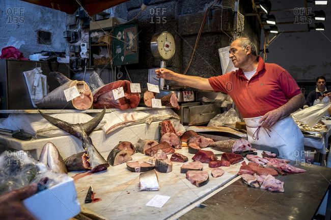 Catania, Sicily, Italy - October 9, 2014: Fishmonger Weighing Fish