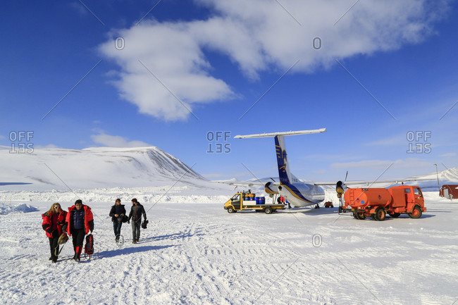 Constable Point, Greenland - April 1, 2015: Charter Plane Lands At Constable Point Airfield Offloading Skiers And Mountaineers