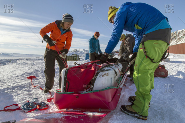 Jameson Land, Scoresby Sound, Greenland - April 16, 2015: Packing And Adjusting Expedition Gear During A Snowmobile Expedition Crossing The Vast Plains Of Jameson Land