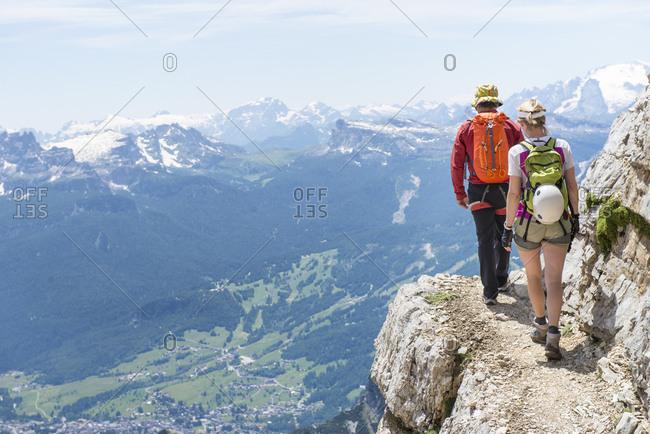 Belluno, Italy - July 3, 2014: Climbing at Via Ferrata Ivano Dibona in the Dolomites, Italy.