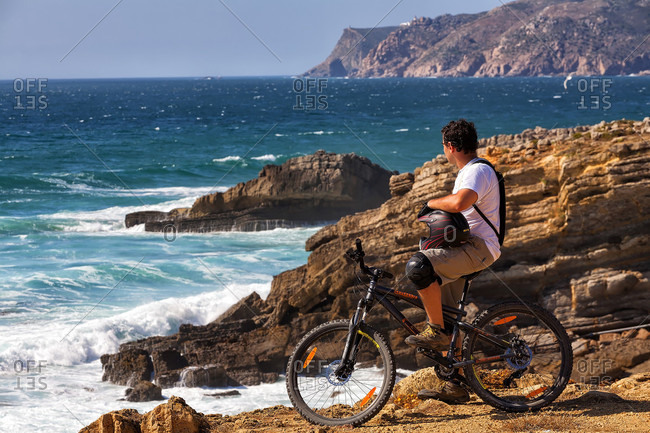 Cascais, Sintra-Cascais, Portugal - May 29, 2015: Cyclist Exploring Oceanic View In Sintra Cascais Natural Park