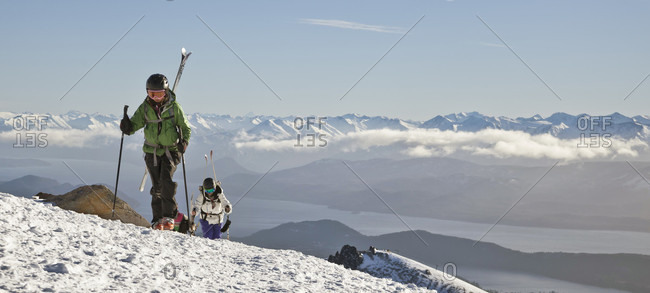 Sans Carlos De Bariloche, Rio Negro, Argentina - July 29, 2012: A Girl Hikes With Skis On Her Back Into The Backcountry At Cerro Catedral In Argentina
