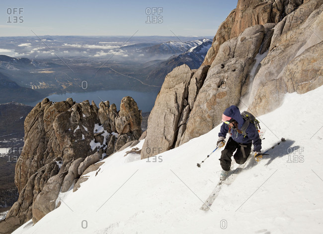 Sans Carlos De Bariloche, Rio Negro, Argentina - July 30, 2012: A Girl On Telemark Ski In The Andes With Town Of Bariloche Can Be Seen In The Distance