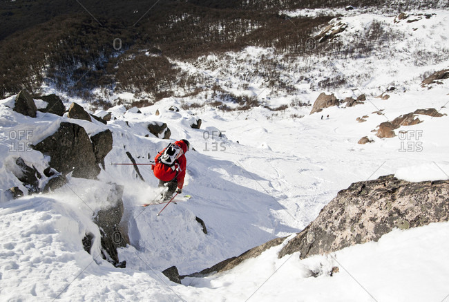 Sans Carlos De Bariloche, Rio Negro, Argentina - July 31, 2012: A Skier Jumping Off Cliff In The Backcountry Of Cerro Catedral In Argentina