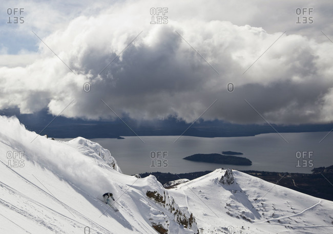 Sans Carlos De Bariloche, Rio Negro, Argentina - August 22, 2012: A Skier Makes A Powder Turn And Sprays Snow Into The Air On A Sunny Day At Cerro Catedral, Argentina