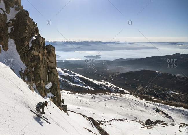 Sans Carlos De Bariloche, Rio Negro, Argentina - August 7, 2012: A Man Makes A Turn On His Skis On A Sunny Day At Cerro Catedral In Argentina