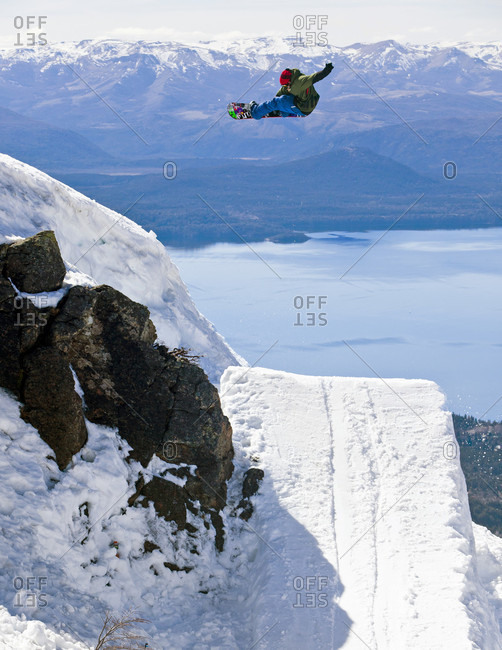 Sans Carlos De Bariloche, Rio Negro, Argentina - September 2, 2012: A Snowboarder Jumping On Snowy Landscape At Cerro Catedral, Argentina