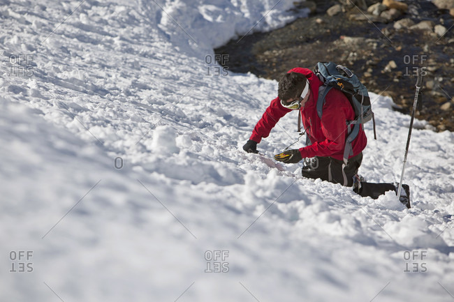 Sans Carlos De Bariloche, Rio Negro, Argentina - July 28, 2013: A Man Practices With His Avalanche Beacon, Before Traveling Near Cerro Catedral In Argentina