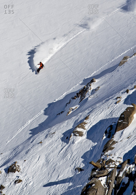 Sans Carlos De Bariloche, Rio Negro, Argentina - August 16, 2013: A Snowboarder Takes A Powder Turn In The Backcountry, Cerro Catedral, Argentina