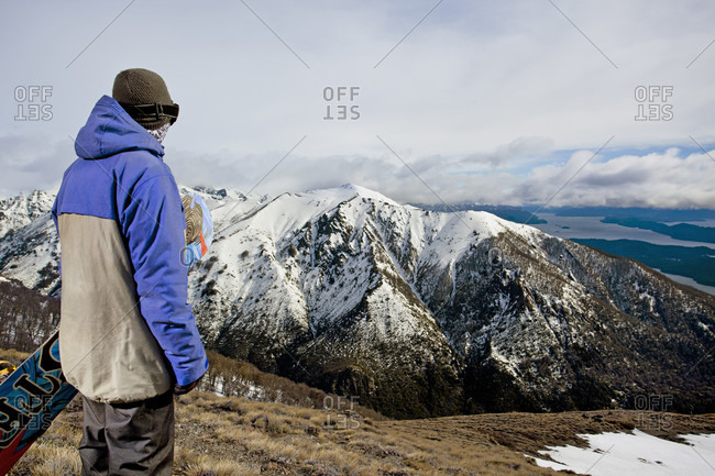 Sans Carlos De Bariloche, Rio Negro, Argentina - August 28, 2013: A Snowboarder Looks Over The Andes Mountains At Cerro Catedral In Argentina