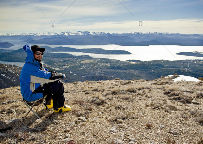Sans Carlos De Bariloche, Rio Negro, Argentina - August 29, 2013: A Skier Enjoys The View Of Lago Nahuel Huapi And The Andes Mountains At Cerro Catedral, Argentina