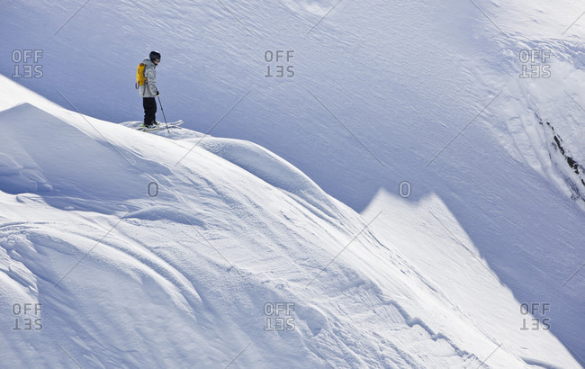 Sans Carlos De Bariloche, Rio Negro, Argentina - August 10, 2014: A Backcountry Skier Stands On A Ridge And Looks Down The Hill To Pick Out His Line At Cerro Catedral In Argentina