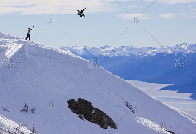 Sans Carlos De Bariloche, Rio Negro, Argentina - August 18, 2014: Snowboarder Hits A Backcountry Jump And Does A Method On A Sunny Day In Cerro Catedral, Argentina
