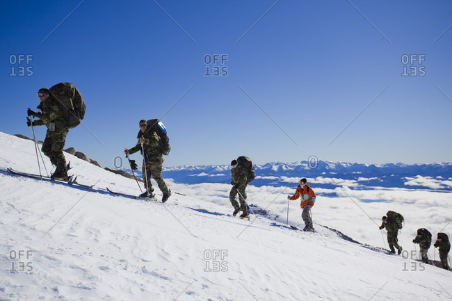 Sans Carlos De Bariloche, Rio Negro, Argentina - August 25, 2014: Professional Skier Hiking On The Snowy Landscape Of Cerro Catedral, Argentina
