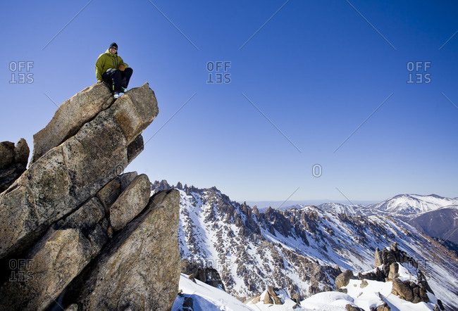 Sans Carlos De Bariloche, Rio Negro, Argentina - August 28, 2014: A Skier Sitting On Top Of Rock In Bariloche, Argentina