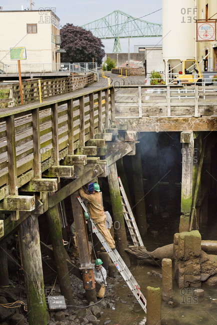 Astoria, Oregon, USA - September 1, 2016: Workers Fixing A Wooden Bridge In Astoria, Oregon, Usa