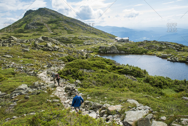 White Mountains, NH, USA - July 15, 2016: Hikers heading to Lakes of the Clouds hut in the White Mountains, NH