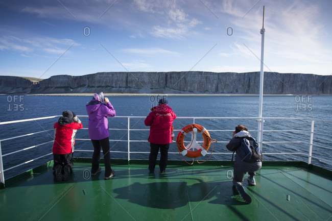 Hudson Straight, Nunavut, Canada - September 13, 2016: Tourists aboard an arctic cruise ship explores the Canadian arctic, landscapes and communities.