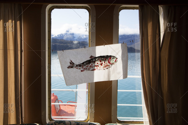 Nuuk, Sermersooq, Greenland - July 27, 2015: A painting of a fish on a cruise ship in the arctic community of Kangerlussuatslag Fjord, Greenland.
