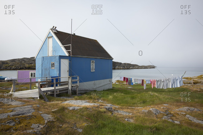 Itilleq, Sermersoog, Greenland - July 28, 2015: Small colorful houses dot the landscape in the arctic village of Itilleq, Greenland.