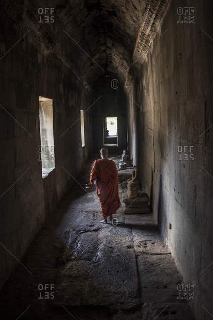 Angkor Wat, Siem Reap, Cambodia - May 3, 2015: Buddhist monk at the Angkor Wat Temple, Siem Reap, Cambodia.