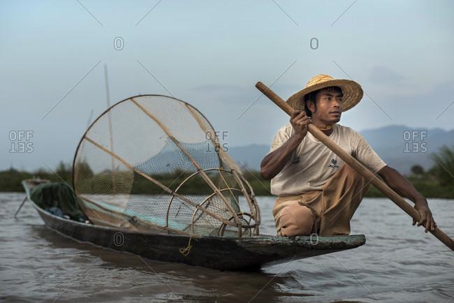 Inle Lake, Nyaungshwe, Myanmar - March 26, 2015: Fisherman at work at the Inle Lake, Nyaungshwe,  Myanmar.