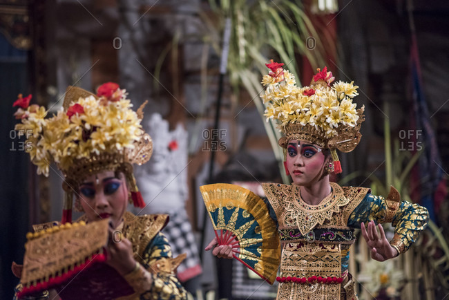 Ubud, Bali, Indonesia - June 19, 2015: Traditional Balinese Legong dancers performing in a theater in Ubud, Bali, Indonesia.