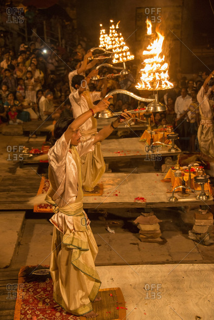 Varanasi, Uttar Pradesh, India - October 12, 2013: Hindu priests raise large aarti lamps during Ganga Aarti at Dashaswamedh ghat, Varanasi, Uttar Pradesh, India