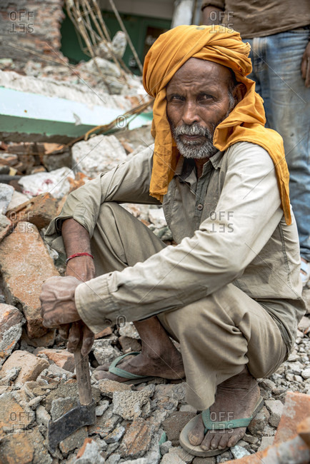 Kathmandu, Kathmandu, Nepal - August 5, 2015: A Laborer Scavenging Bricks From The Earthquake Wreckage In Kathmandu, Nepal