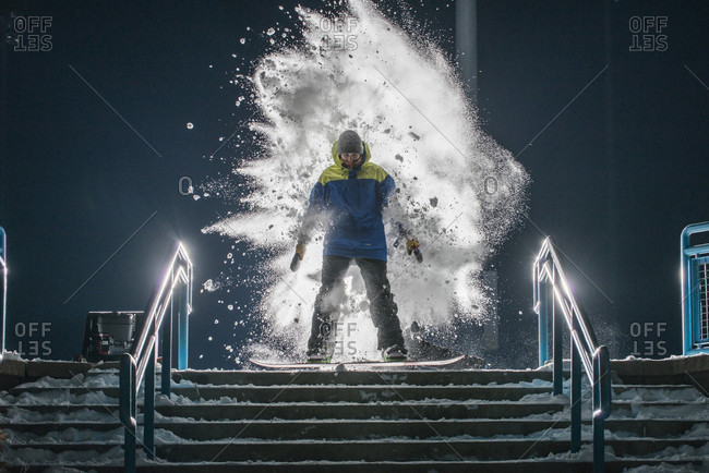 arvada, colorado, usa - December 28, 2014: Snowboarder getting hit with a shovel full of snow on a staircase in Arvada, Colorado.