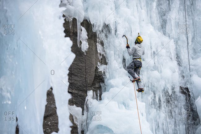 Ceresole Reale, Piemonte, Italy - February 23, 2016: Professional climber Herve Barmasse ice climbing and drytooling in Ceresole Reale ice park, Piemonte, Italy.