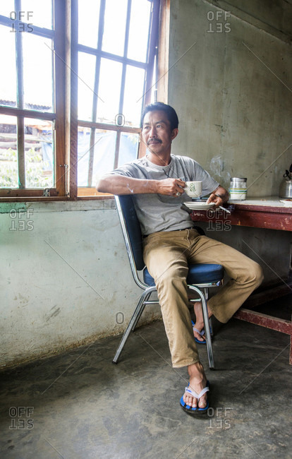 Kerinci Valley, Sumatra, Indonesia - February 20, 2015: The owner of a coffee processing facility in the Kerinci Valley of Sumatra, Indonesia.