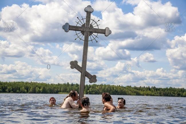 Tikhvin, Saint Petersburg, Russia - August 9, 2017: Group Of People Praying In Lake Tikhvin, Russia