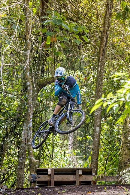 Kintamani, Bali, Indonesia - October 1, 2016: Mountain Biker Riding Through The Rainforest In Bali, Indonesia