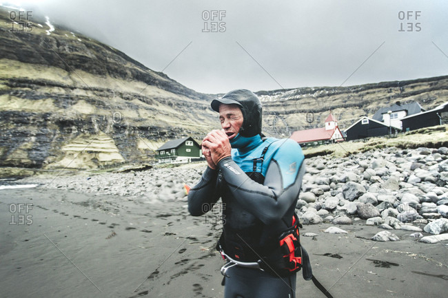 Streymoy, Faroe Islands, Faroe Islands - April 30, 2015: Male Windsurfer Standing On Beach Of The Faroe Islands