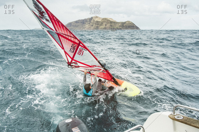 Streymoy, Faroe Islands, Faroe Islands - May 3, 2015: Man Windsurfing On Sea At Faroe Islands