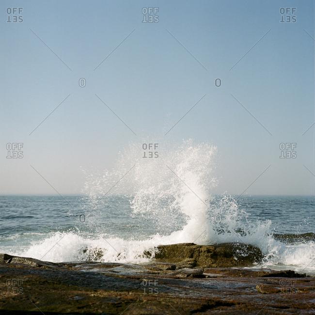 Waves splashing on rocky shore