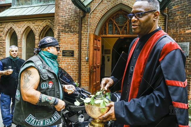 New York City, New York - August 5, 2017: Pastor and bikers at a blessing ceremony at a church