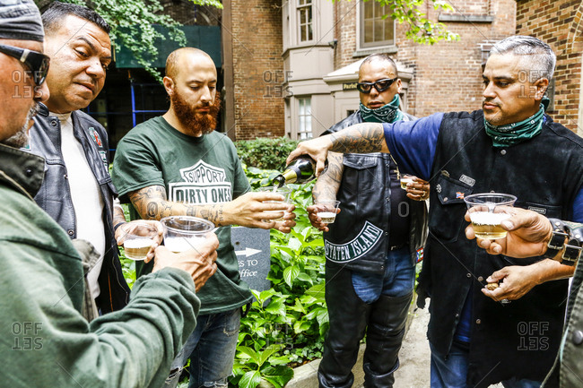 New York City, New York - August 5, 2017: Group of bikers having champagne at a blessing ceremony