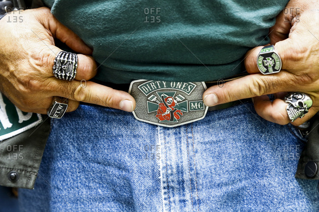 New York City, New York - August 5, 2017: Close up of biker holding middle fingers up to belt buckle