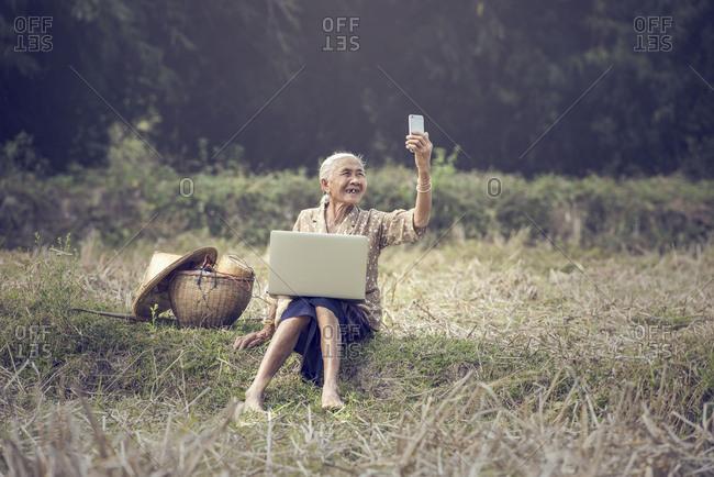 Asian woman taking selfie